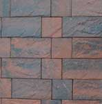 Brindle colour swatch of Lakeland Windermere Riven Block Paving in wet conditions.