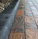 Charcoal Kerb with Driveway in Lakeland Windermere Riven Block Paving in Burnt Sunset, 50mm thickness.