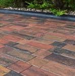 Driveway in Lakeland Windermere Riven Block Paving in Burnt Sunset, 50mm thickness.