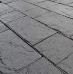Wet conditions of Lakeland Windermere Riven Block Paving in Charcoal, 50mm thickness.